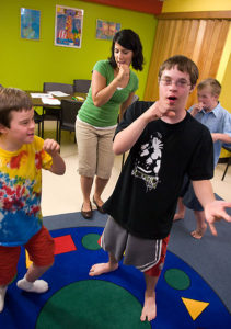 Children with down syndrome partake in speech-language therapy